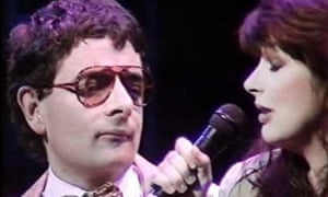 Rowan Atkinson duets with Kate Bush for Comic Relief.