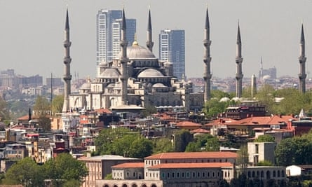 Coming down … The OnaltiDokuz towers in Istanbul, shown here looming above the Suleymaniye mosque, now face demolition after a court order.