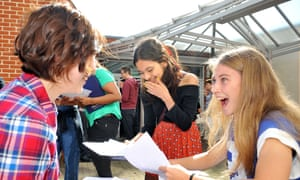Amy Wang, Shamika Tamhane and Madeleine Henderson react after receiving their GCSE results at Chelmsford County High School for Girls in Chelmsford, Essex.