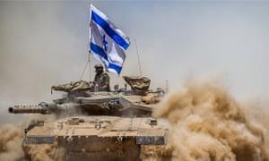 An Israeli tank flies the flag of Israel 3 August 2014