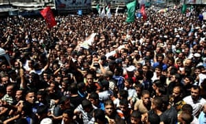 Crowds gather for the funeral of three senior Hamas commanders in Gaza.