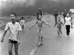 South Vietnamese forces follow after terrified children, including 9-year-old  Kim Phuc, center, as they run down Route1 near Trang Bang after an aerial napalm attack on suspected Viet Cong hiding places on June 8, 1972