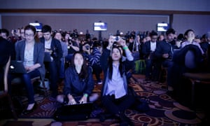 Members of the media use mobile tech at a news conference for Samsung