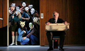 'Fierce frieze': Peter Eyre and the masked revellers in Minetti.