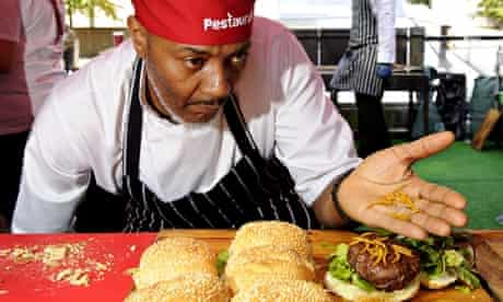 A Pestaurant chef shows off sweet chilli pigeon burgers, garnished with cheddar cheese mealworms.