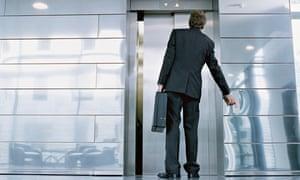 Businessman outside lift