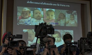 Thai police display pictures of the surrogate babies