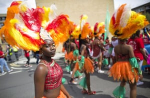 Performers in costumes parade on the first day of the Notting Hill Carnival.