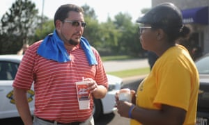Ferguson Mayor James Knowles III (L) speaks to a participant during a peaceful rally in Canfield Apartments.