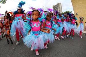 Participants in the parade on Children's Day at Notting Hill Carnival. The first day of the carnival is traditionally for children but plenty of adults join in as well.