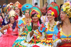 Participants dressed in the traditional Russian costumes parade during the Notting Hill Carnival, London.