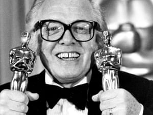 """British actor and director Richard Attenborough holds his two Oscars for his epic movie """"Gandhi""""."""