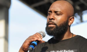 Michael Brown Sr speaks to the crowd in St Louis on Sunday.