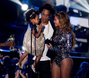 Rapper Jay Z and singer Beyonce with daughter Blue Ivy Carter onstage during the 2014 MTV Video Music Awards.