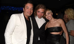 Comedian Jimmy Fallon, My Friend's Place representative Jesse, and recording artist Miley Cyrus attends the 2014 MTV Video Music Awards.