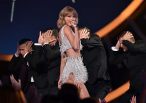 Singer Taylor Swift performs onstage.