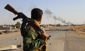 Kurdish peshmergas fight against Islamic State militants to regain the control of the town of Celavle in Diyala province, Iraq.