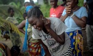 Relatives of Baindu Koruma, who died due to the Ebola virus, mourn in Lango village, in Kenema, Sierra Leone. The virus has claimed hundreds of lives in Sierra Leone, Guinea and Liberia.