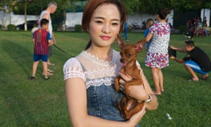 Woman with pet dog in Hanoi park