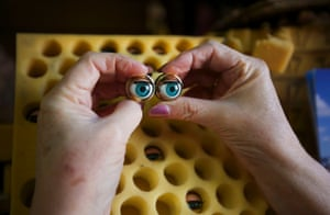 Stuart, who has worked at the hospital for 25 years, matches a pair of eyes from her stock to be inserted into a customer's doll undergoing repairs.