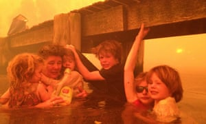 Australia's hottest year of 2013 started with a heatwave that caused widespread bush fires. In January the Holmes family from Tasmania took refuge under a jetty as wild fires raged around them.