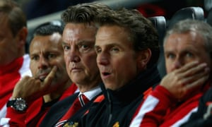 Louis van Gaal and colleagues watch as Manchester United lose to MK Dons.