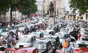 Taxis blockade Whitehall on June 11, 2014 in London, campaigning against the introduction of the 'Uber' taxi smartphone app in the United kingdom.