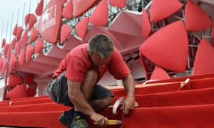 Finishing touches …work comes to a close on the red carpet in front of the entrance of the Lido Casino a day before the opening ceremony of the 71st Venice film festival.