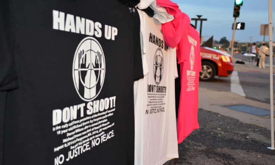 """T-shirts on sale from a street vendor that bear the message """"Hand up, don't shoot"""" in reference to the shooting dead of 18-year-old Michael Brown by a police officer in Ferguson, Missouri on August 9th, 2014."""