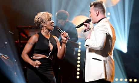 Mary J Blige duets with Sam Smith on Stay With Me for an encore at Smith's show at the Apollo theatr