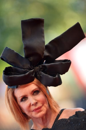 Taking a bow: Italian actor Marina Ripa di Meana shows off her dramatic hat. Photograph: Tiziana Fabi//AFP/Getty Images
