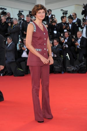 Jury member Alice Rohrwacher coordinated her retro trouser suit with the red carpet. Photograph: Corbis