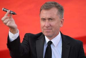 Jury member Tim Roth seems prepared to sign autographs on the red carpet. Photograph: Andrea Merlo/EPA