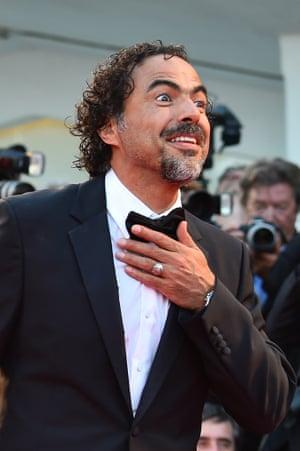 Birman director Alejandro González Iñárritu pulls faces for the cameras. Photograph: Gabriel Bouys/AFP/Getty Images