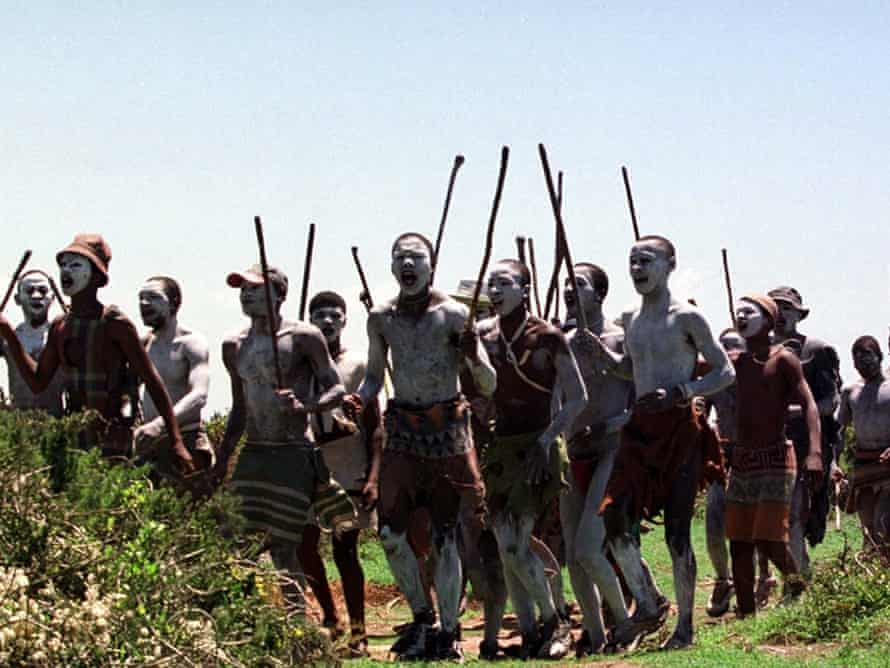 Young men chant and wave sticks near Port Elizabeth during ceremonies to mark their passage into manhood.