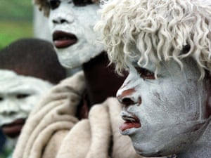 Abakhwetha, the Xhosa word for initiates, near the Eastern Cape Province town of East London, South Africa. With white clay covering their faces as a symbol of purity, they wear sheepskins to protect them from the cold, as they near the end of their ritual initiation into manhood.