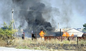 Black smoke billows over fire after shelling in Novoazovsk