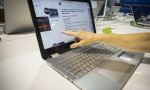 A shopper inspects an HP laptop computer in a Best Buy electronics store in New York.