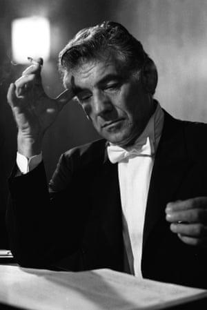 Leonard Bernstein looking over score in concert dress, 1968
