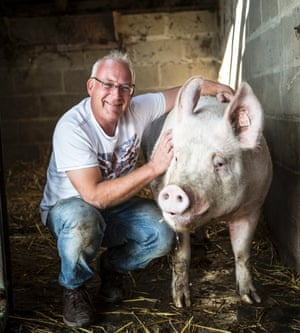 Mark Heywood with a prize pig at Dingley Dell Farm in Suffolk