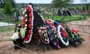 Freshly dug grave is seen at the Vybuty cemetery in the Pskov region.