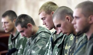 A handout photo provided by the Unian Agency shows Russian paratroopers captured by Ukrainian forces near the village of Dzerkalne, Donetsk region, some 20 to 30 kilometres from the Russian border.