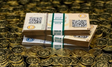A Bitcoin enthusiast's coins and paper vouchers used as a way to store Bitcoins offline.