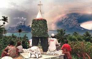 A file photo dated September 22, 1994, shows Rabaul residents on a hill overlooking Simpson Harbour watching the devastating volcanic eruptions of Mt Tavurvur and Mt Vulcan which destroyed much of their city.