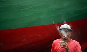 A man smokes a cigarette in Jakarta