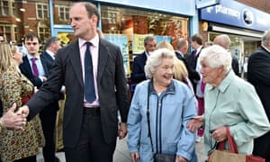 Douglas Carswell meets passers-by as he walks through Clacton-on-Sea