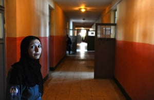 An Afghan police officer looks on inside the facility.