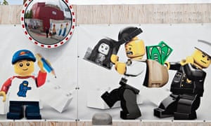 Lego characters adorn the fencing around the site of the new Lego House in Billund, Denmark