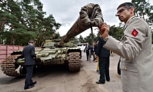 A military attache examines a Russian tank
