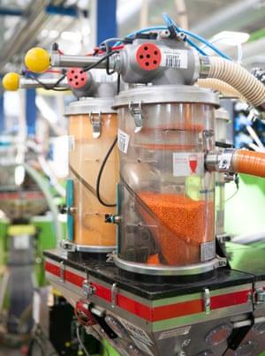 Orange dye is pumped into a moulding machine